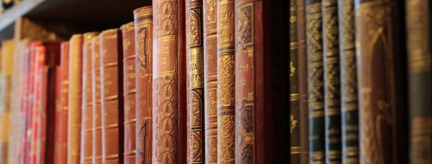 books on a shelf for post about the greatest success books of all time