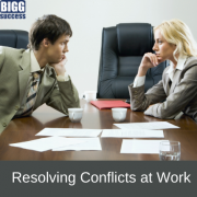 image of 2 people in office looking tense with the title: Resolving conflicts at work