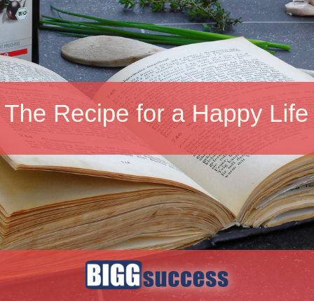 Image of a recipe book with the title of the blog post: The recipe for a happy life