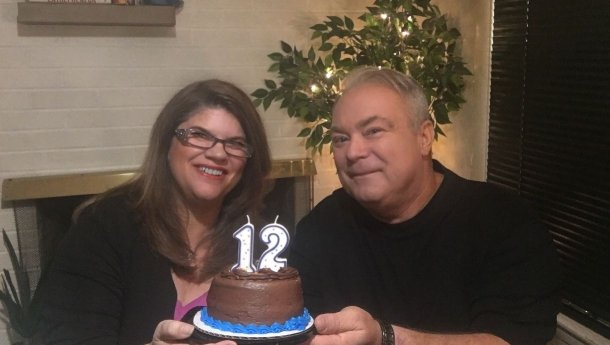 12-years-of-BIGG-Success-George-and-Mary-Lynn-holding-cake