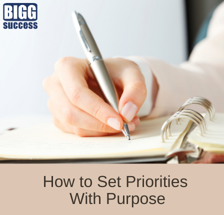 woman writing on paper with the blog post title How to Set Priorities With Purpose