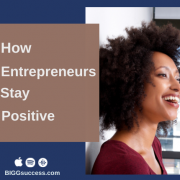 Image of smiling woman with blog post title How entrepreneurs stay positive